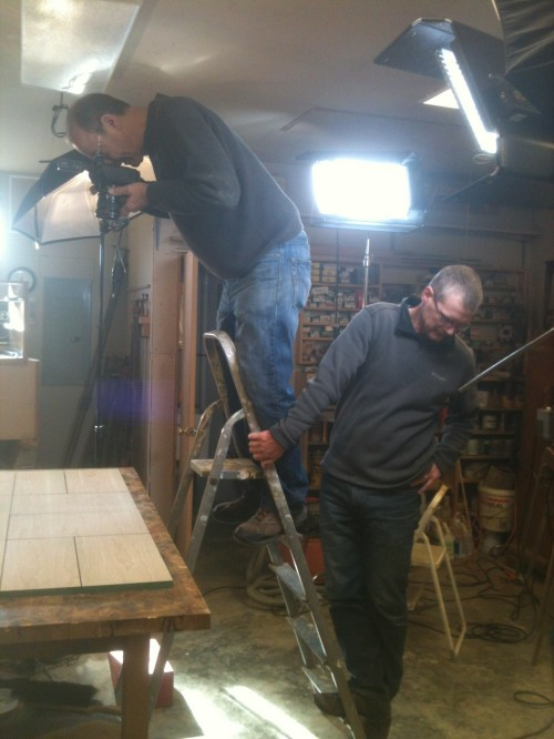 Senior Editor Chuck Bickford photographs the drawer faces and doors while videographer John Ross steadies the ladder.