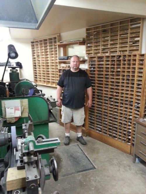 Chris Ballard of Indiana Hardwood Mills, surrounded by his ever-expanding collection of custom-ground knives