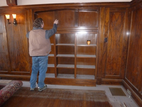 My helper on Phase I, John Dehner, with the built-in bookcase before demolition