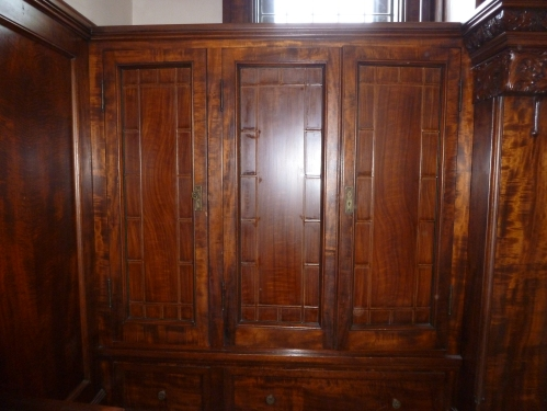 Faux grained to the max. These doors are not wood, but leaded glass, painted to match the surrounding woodwork in order to conceal the cupboard's contents. Though not original to the house, this paintwork is the work of a master craftsperson.