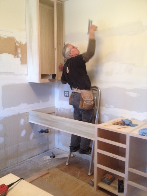 Duncan repairs the wall
