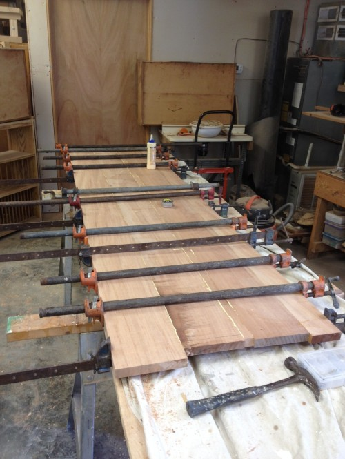 The nine-foot mahogany counter in clamps