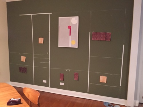 Chalk and tape layout on wall